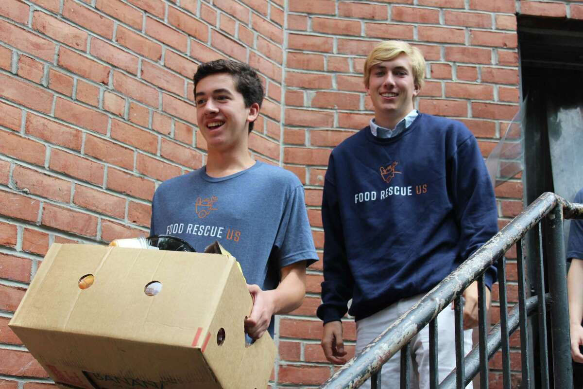Kai Jennings and Elliot Carlson rescue their last box of food from Whole Foods, destined for Kids in Crisis, during of their month-long internship opportunity through GHS. Jennings, Carlson and three other GHS seniors created their own internship, partnering with Food Rescue US to pick up food from partner grocers and shops and drop the boxes off at nonprofits in Greenwich and Stamford.