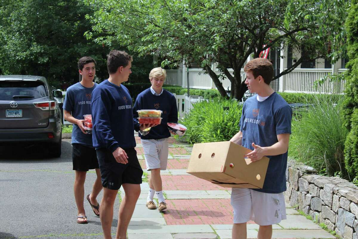 Luke Blaine, Kai Jennings, Elliot Carson and Alex Bound rescue their last box of food from Whole Foods, destined for Kids in Crisis, during of their month-long internship opportunity through GHS. Five GHS seniors created their own internship, partnering with Food Rescue US to pick up food from partner grocers and shops and drop the boxes off at nonprofits in Greenwich and Stamford.