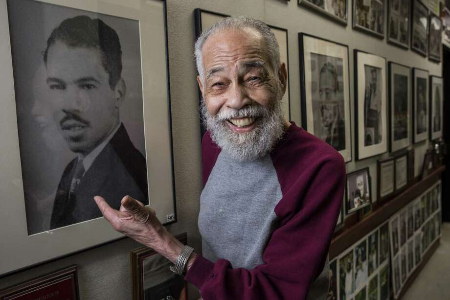 Dr. Thomas Freeman, founding dean of the Texas Southern University Honors College and longtime debate team director, points to a photo of himself from the 1950s as he stands in the hallway outside his office on Wednesday, June 19, 2019, in Houston. Freeman has worked at the university for the past 70 years and has led the debate team to dozens of championships. He will turn 100 years old on June 27, and the university community is throwing a host of birthday festivities in celebration. Photo: Brett Coomer, Houston Chronicle / Staff Photographer / © 2019 Houston Chronicle