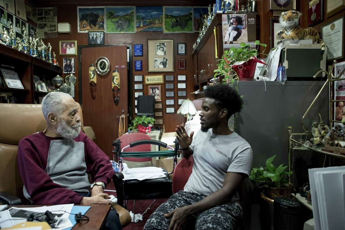 Dr. Thomas Freeman, founding dean of the Texas Southern University Honors College and longtime debate team director, left talks to student Kayse Musse in his office on Wednesday, June 19, 2019, in Houston. Freeman has worked at the university for the past 70 years and has led the debate team to dozens of championships. He will turn 100 years old on June 27, and the university community is throwing a host of birthday festivities in celebration.