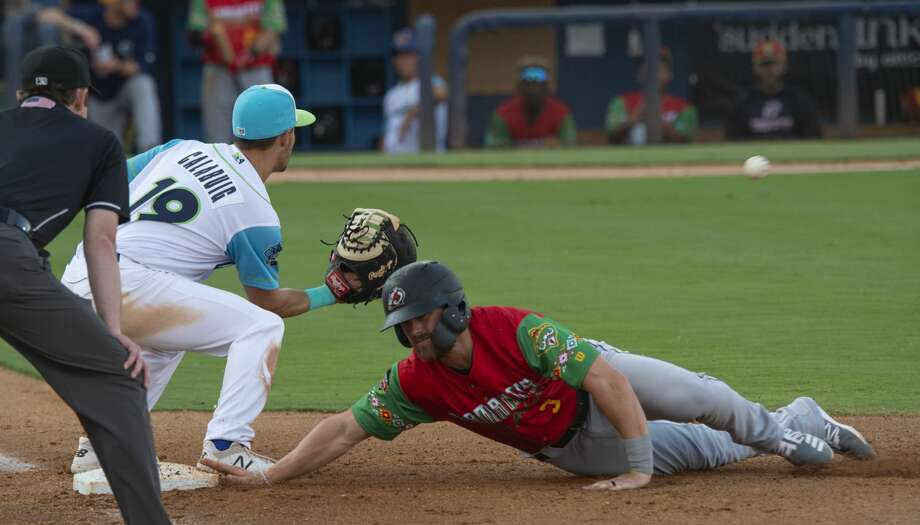 RockHounds' Chase Calabuig tries to make a tag on Travelers' Logan Taylor at first 06/21/19 at Security Bank Ballpark. Tim Fischer/Reporter-Telegram Photo: Tim Fischer/Midland Reporter-Telegram