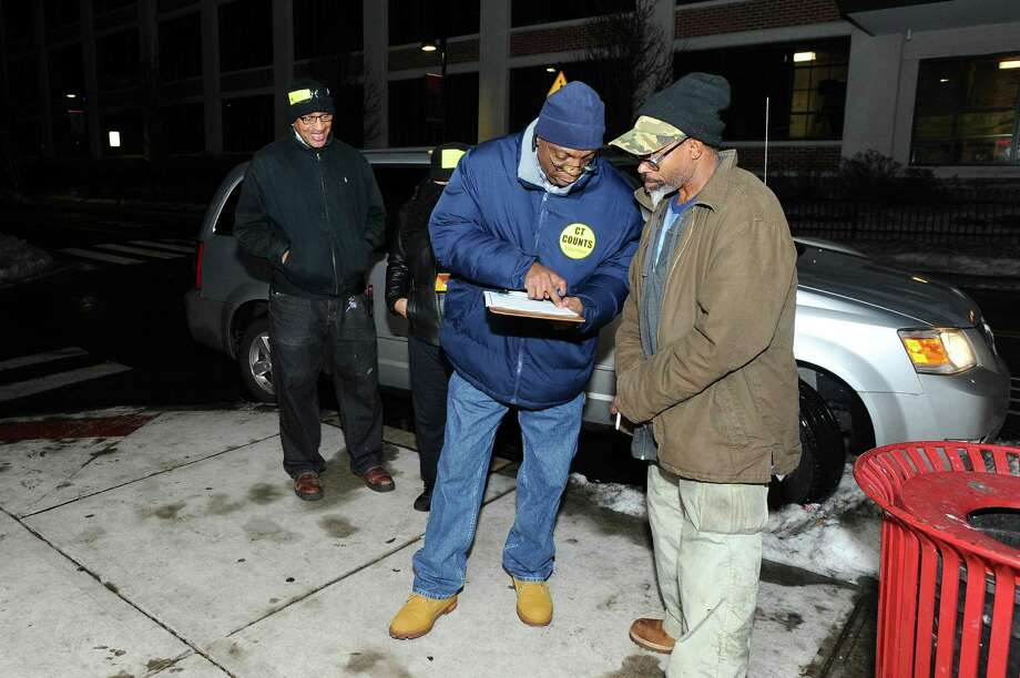 File photo showing: Volunteers Leroy Jordan (center) and Vertiz Waters (left) fills out a survey with Keith Thompson's (right) information to help document those in need in Stamford in the South End on Tuesday, Jan. 26, 2016. Photo: Hearst Connecticut Media File Photo / Stamford Advocate