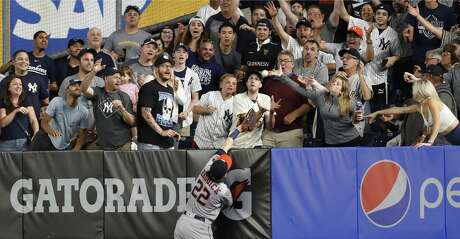 Houston Astros right fielder Josh Reddick (22) can't catch a two-run home run by New York Yankees' Gleyber Torres during the seventh inning of a baseball game Friday, June 21, 2019, in New York. (AP Photo/Kathy Willens)