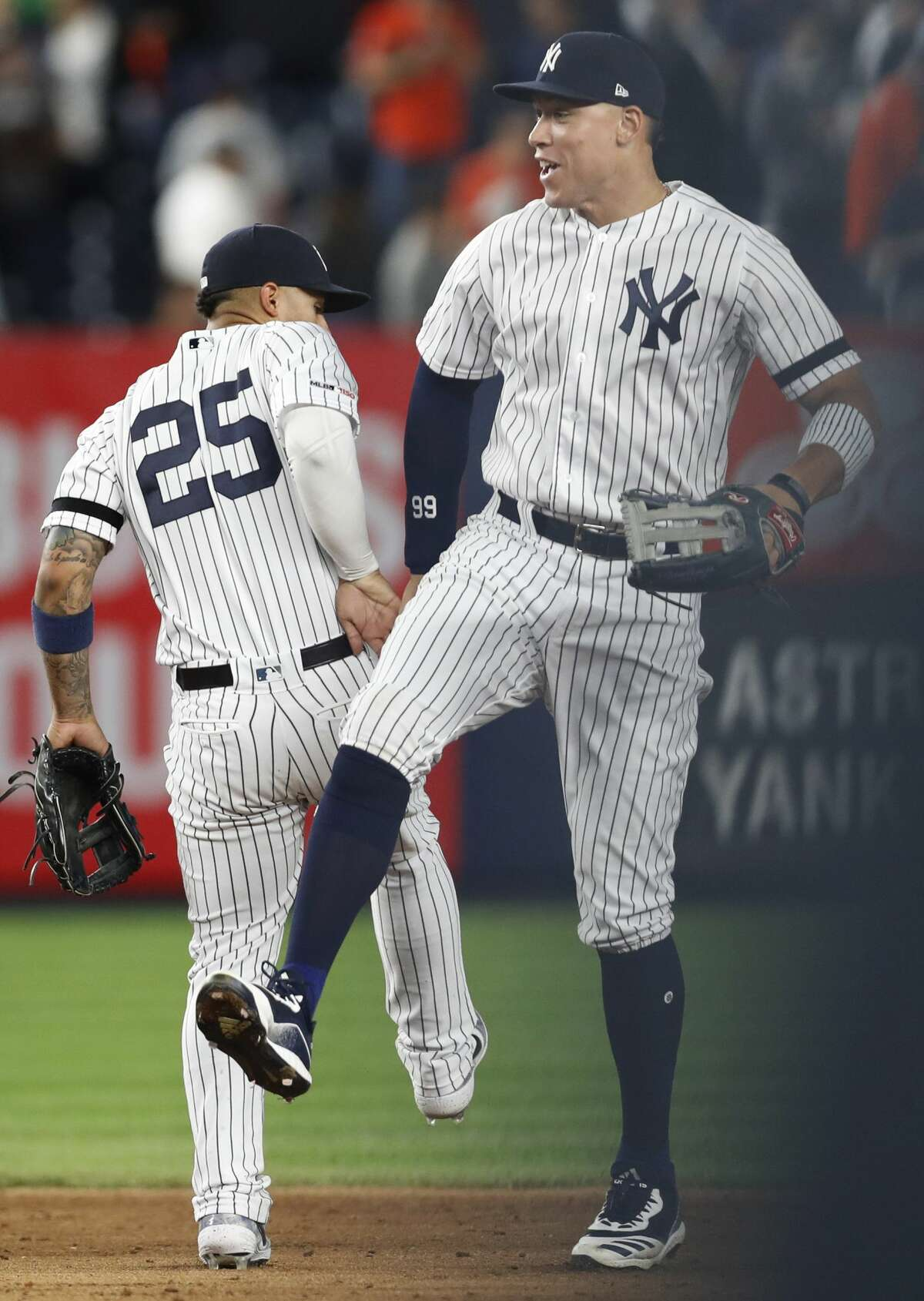 New York Yankees right fielder Aaron Judge, right, celebrates with second baseman Gleyber Torres after the Yankees defeated the Houston Astros 4-1 in a baseball game Friday, June 21, 2019, in New York. (AP Photo/Kathy Willens)
