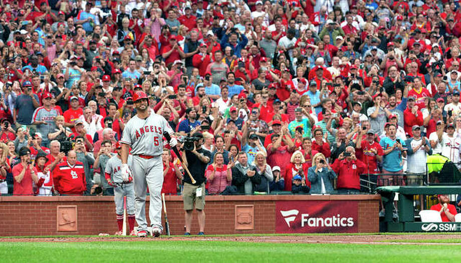 Former Cardinal Albert Pujols (5) is greeted by a standing ovation before his first at-bat in the first inning of Friday night's game against the Cardinals at Busch Stadium. Photo: AP Photo