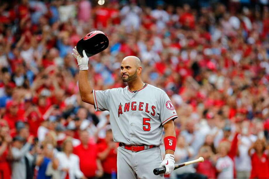 Former St. Louis Cardinal Albert Pujols #5 of the Los Angeles Angels of Anaheim acknowledges a standing ovation from the fans in his first return to Busch Stadium prior to batting against the St. Louis Cardinals on June 21, 2019 in St Louis, Missouri. (Photo by Dilip Vishwanat/Getty Images) Photo: Dilip Vishwanat / Getty Images