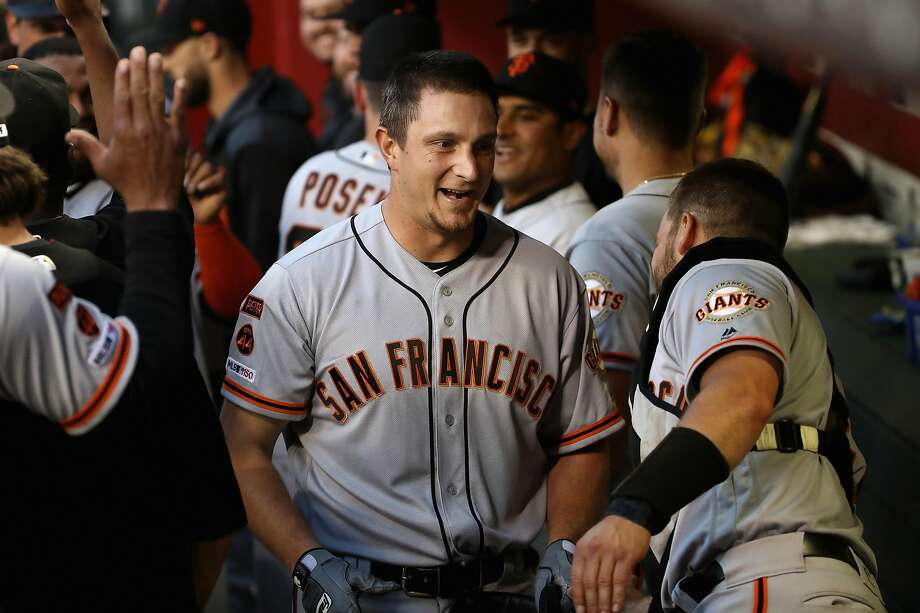 PHOENIX, ARIZONA - JUNE 21:  Alex Dickerson #8 of the San Francisco Giants is congratulated by teammates in the dugout after hitting a grand-slam home run against the Arizona Diamondbacks during the third inning of the MLB game at Chase Field on June 21, 2019 in Phoenix, Arizona. (Photo by Christian Petersen/Getty Images) Photo: Christian Petersen / Getty Images