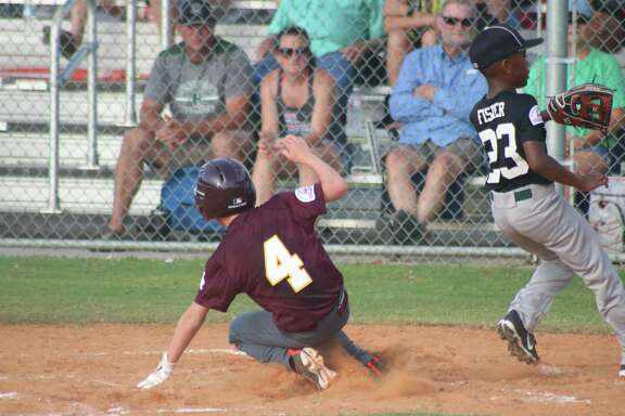 Deer Park's Shay Kight takes advantage of a wild pitch to increase the team's lead over Huntsville to 8-1 in the second inning Friday night. The club returns to action Saturday morning at 10 to take on La Porte.