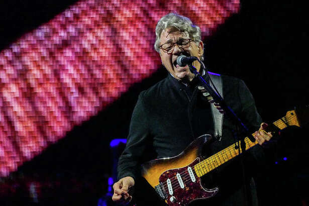 """As if Steve Miller himself proclaimed, """"Abracadabra,"""" Friday's incessant rain broke with perfect timing just before rockabilly icon Marty Stuart and rock 'n roll hall-of-famer Steve Miller Band took to the stage in the parking lot of Alton Square Mall to a likely sell-out crowd. The concert was originally slated for Liberty Bank Alton Amphitheater, but was moved due to flooding. Persisting rain gave way to near perfect weather for Friday evening's show. A security worker told a Telegraph reporter that 2,400 were expected to attend, but estimated the actual crowd was well over that, possibly higher than 3,000. Official numbers were not immediately available."""