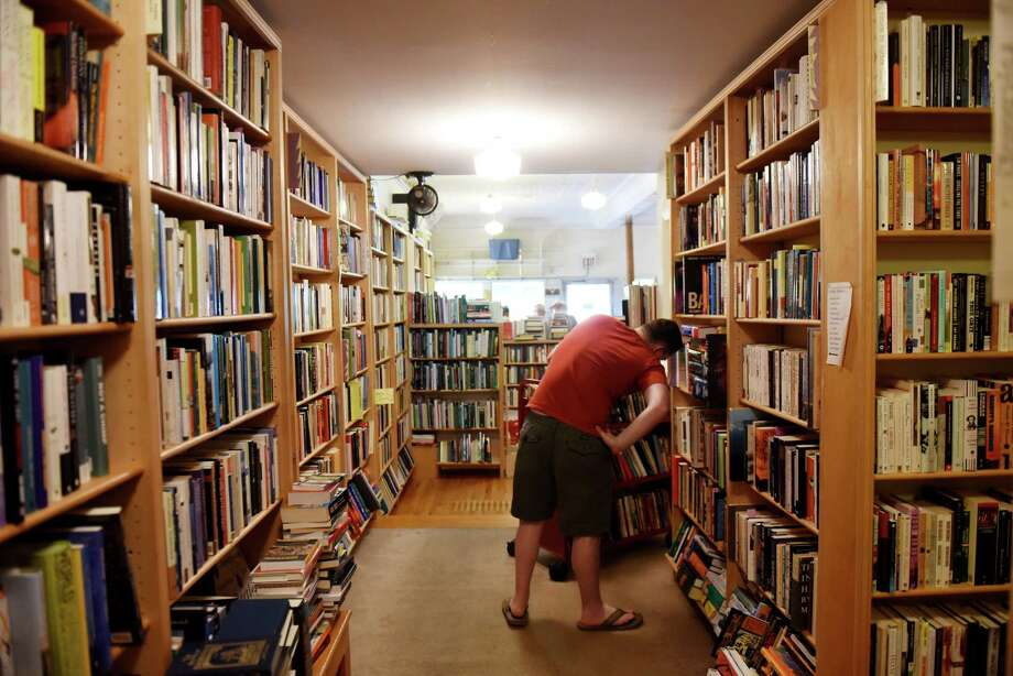 Customers search for a good read at Dove and Hudson bookstore on Friday, June 21, 2019, in Albany, N.Y. Store owner Dan Wedge is celebrating his 30th year owning the bookstore. (Will Waldron/Times Union) Photo: Will Waldron, Albany Times Union / 20047306A