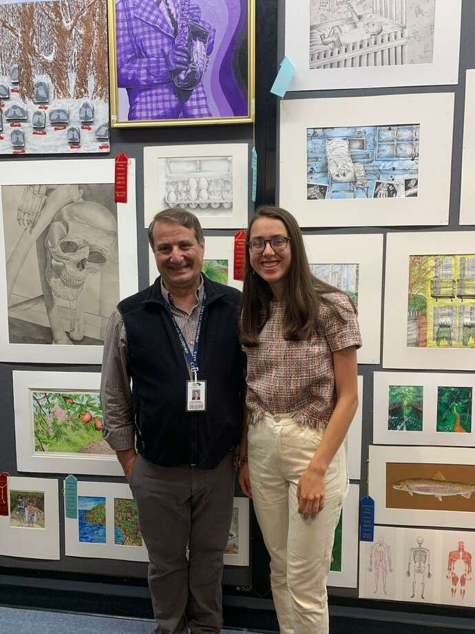 Stamford High retiring teacher and Art Department head Paul Cusano poses with senior Ivy Zingone at this year's annual art show. Photo: Abby Wexler / Contributed Photo