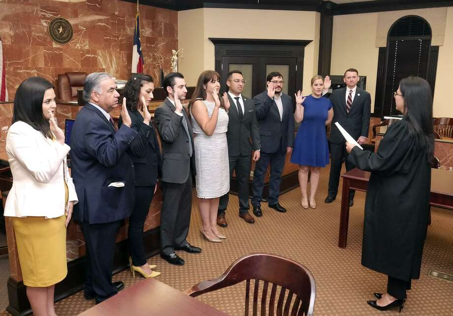 The Laredo-Webb County Bar Association (LWCBA) Executive Board was sworn in Friday by District Judge Beckie Palomo at the 341st District Court in the Webb County Criminal Justice Center. Pictured swearing in left to right are Kassandra De Hoyos, Armando X. Lopez, Jackeline Neira, Eduardo Davila Jr., Alyson A. Martinez, Rogelio Soto Jr., Ernesto R. Cavazos Jr., Julia Rubio and Albrecht C. Riepen. Photo: Cuate Santos /Laredo Morning Times / Laredo Morning Times