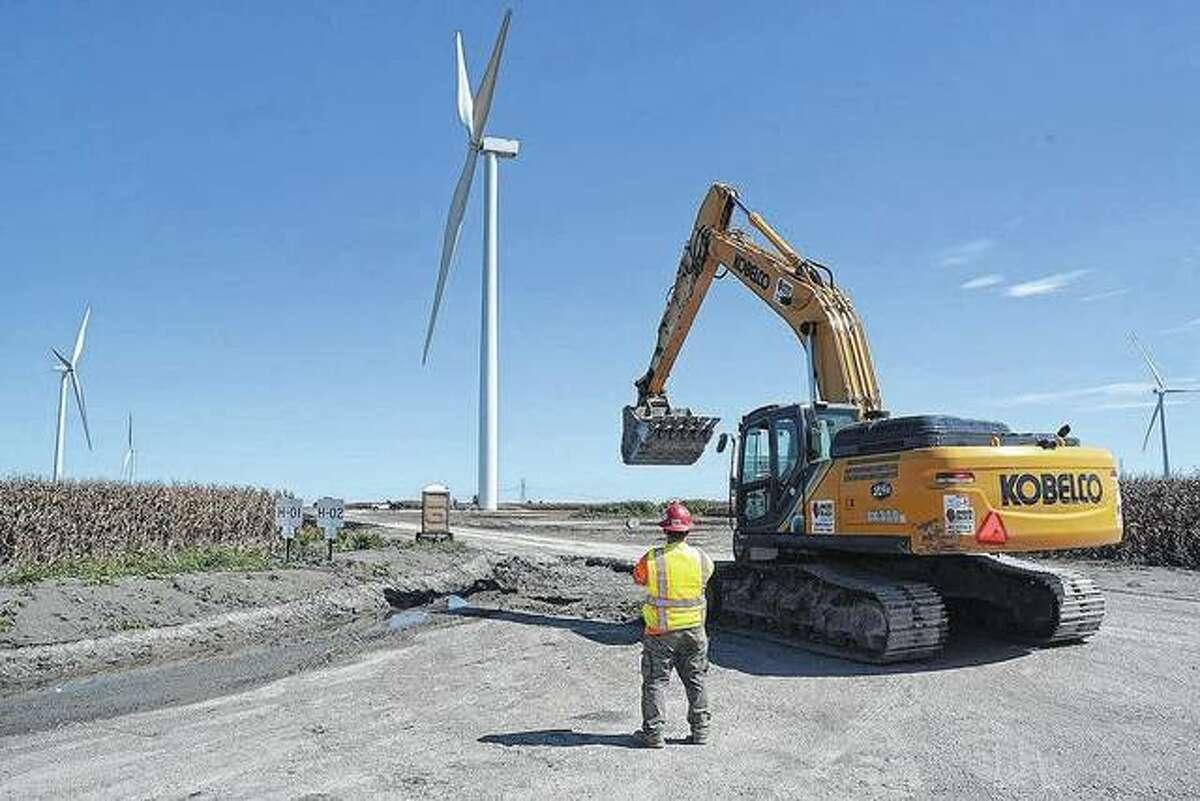 Crews construct turbines and access roads at Hilltopper Wind Farm near Mount Pulaski in 2018.