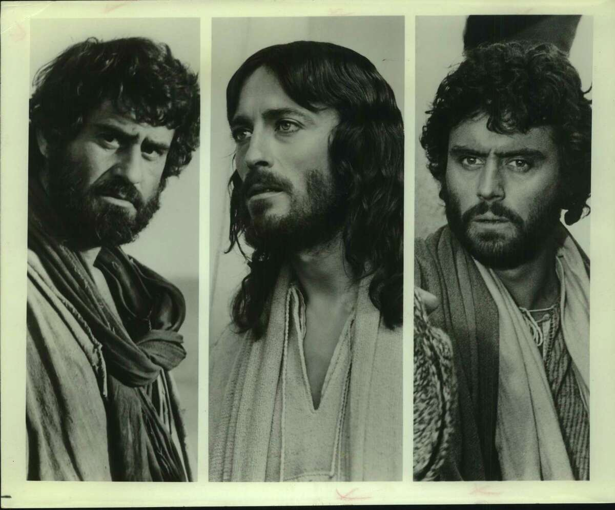 """""""Jesus of Nazareth,"""" the award-winning story of the life of Christ, stars Robert Powell (center) as Jesus. James Farentino portrays Simon Peter (left) and Ian McShane is Judas in the Biblical epic directed by Franco Zeffirelli and sponsored by the products of the Procter & Gamble Company. The eight-hour television special included footage never before seen in this country."""