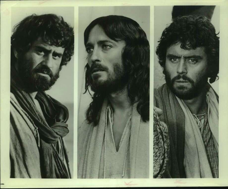 """""""Jesus of Nazareth,"""" the award-winning story of the life of Christ, stars Robert Powell (center) as Jesus. James Farentino portrays Simon Peter (left) and Ian McShane is Judas in the Biblical epic directed by Franco Zeffirelli and sponsored by the products of the Procter & Gamble Company. The eight-hour television special included footage never before seen in this country. Photo: / NBC (National Broadcasting Company) / San Antonio Express-News"""