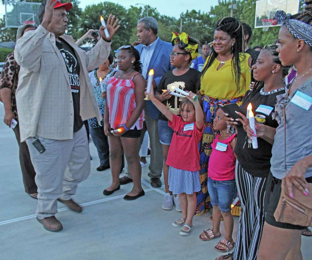 Reginald Moore, founder and president of the Convict Leasing and Labor Project (CLLP), speaks at a Juneteenth candlelight vigil honoring the Sugar Land 95 at Mayfield Park on Tuesday, June 18.