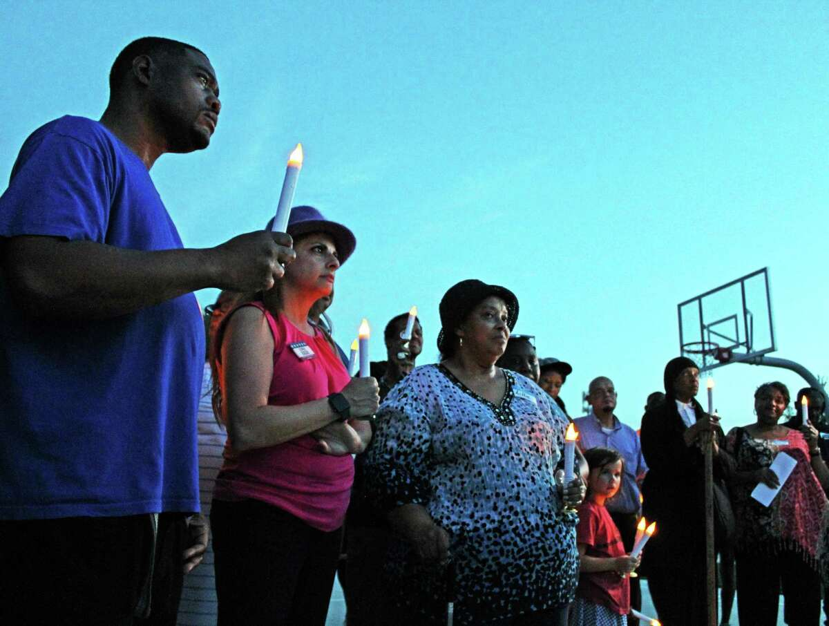 A candlelight vigil was held in honor of Juneteenth and the Sugar Land 95 at Mayfield Park on Tuesday, June 18.