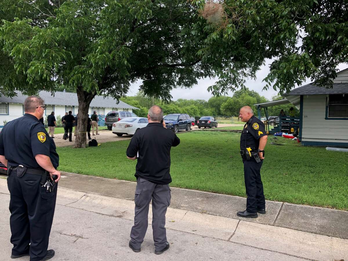 Bexar County Sheriff's Office deputies investigate a shooting where an off-duty deputy was shot confronting a car burglary suspect at the deputy's South Side residence Saturday morning, June 22, 2019.