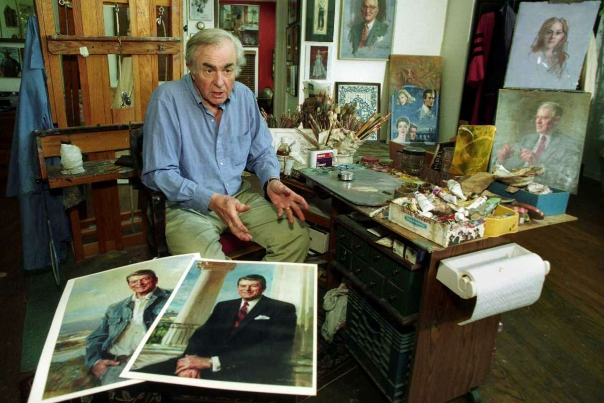 Artist Everett Raymond Kinstler talks in his Easton studio about President Ronald Reagan. Kinstler painted the official White House portrait of President Reagan. A copy of that portrait can be seen in the foreground, along with a copy of another Kinstler painting of Reagan that hangs in the Cowboy Hall of Fame in Oklahoma.