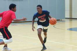 Onterio Hagan and Colin Johnson participate in a one-on-one drill at the Dawson summer basketball camp.