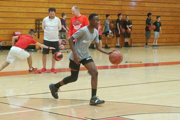 Mike Wandji goes to work at the Clear Brook summer basketball camp.