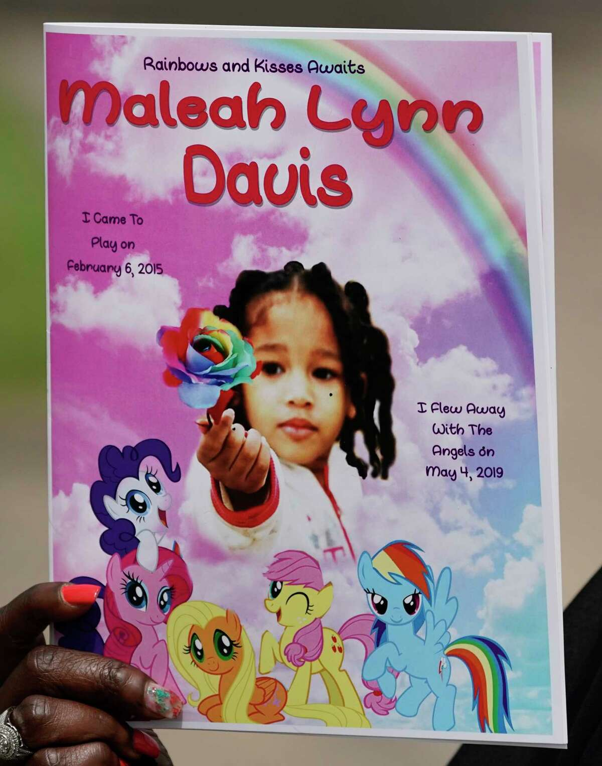A funeral program is displayed by an attendee after the service for 4-year-old Maleah Davis held at the Crossing Community Church, 3225 W Orem Dr., Saturday, June 22, 2019, in Houston. Derion Vence, the former fiance, of her mother, Brittany Bowens, is charged in connection with her death. Maleah was reported missing May 4 in what Vence first said was an abduction. Maleah's remains were found May 30 in Arkansas.