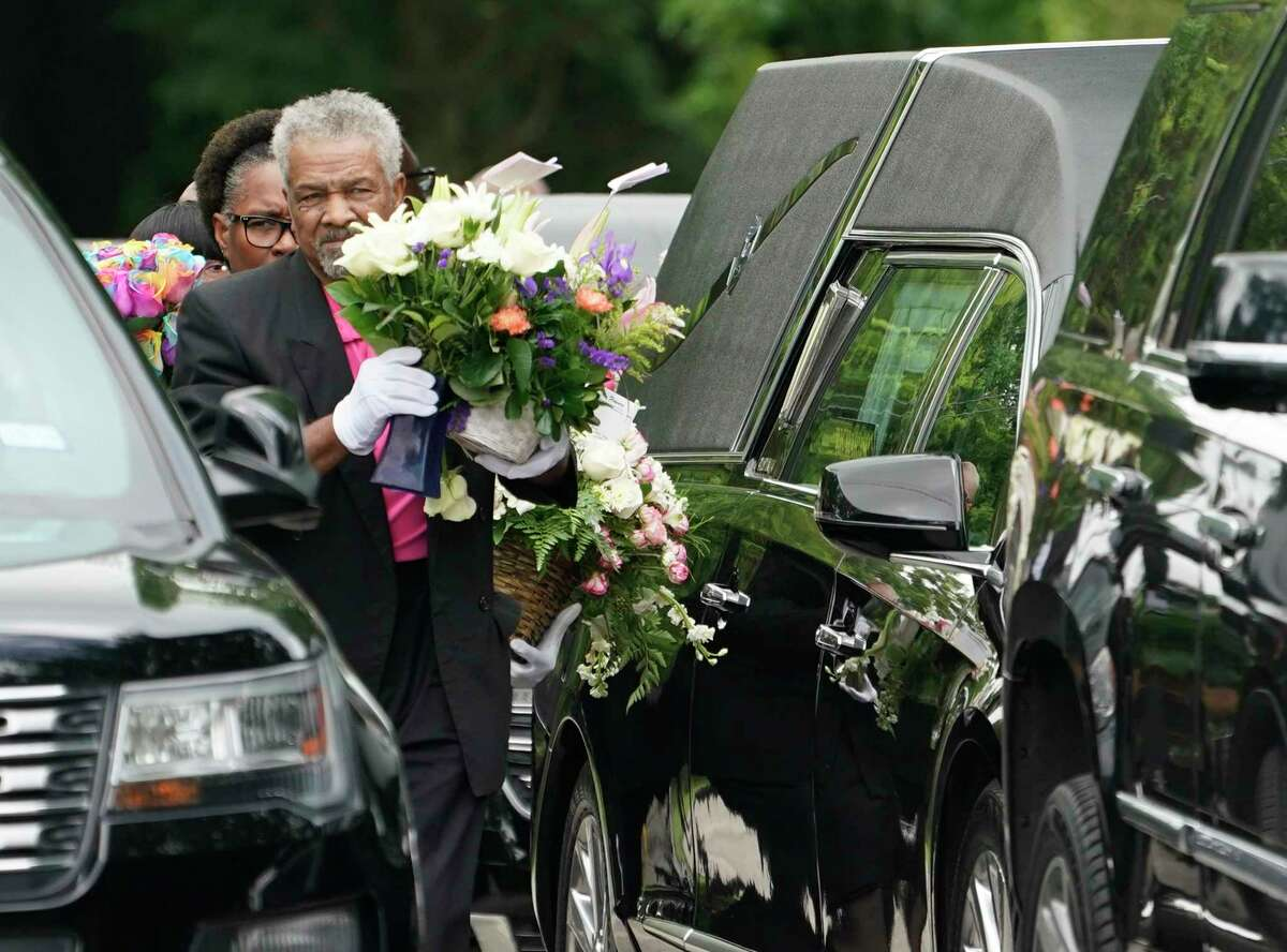 Flowers are carried out after the funeral service for 4-year-old Maleah Davis held at the Crossing Community Church, 3225 W Orem Dr., Saturday, June 22, 2019, in Houston. Derion Vence, the former fiance, of her mother, Brittany Bowens, is charged in connection with her death. Maleah was reported missing May 4 in what Vence first said was an abduction. Maleah's remains were found May 30 in Arkansas.