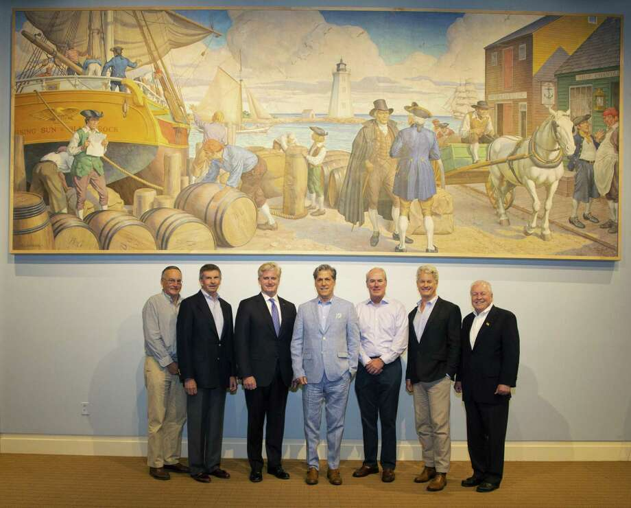 From left with mural, Phil Blagys, Black Rock Community Council; Bruce Hubler, Bill Tommins, Southern Connecticut market president, Bank of America;  Ronald Marshall, Jack Collins, Mike Jehle, executive director Fairfield Museum; Mike Tetreau, Fairfield First Selectman. Photo: Contributed Photo / Photo By Capitol PhotoInteractive