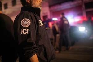 File photo: An ICE agent with U.S. Homeland Security Investigations (HSI), watches as Guatemalan police investigate the scene after detaining a suspected human trafficker on May 29, 2019 in Guatemala City.