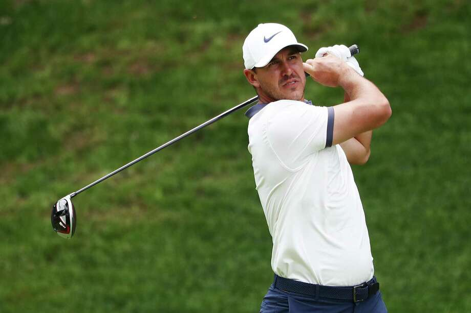 Brooks Koepka plays his shot from the 15th tee during Saturday's third round of the Travelers Championship at TPC River Highlands in Cromwell. Photo: Tim Bradbury / Getty Images / 2019 Getty Images