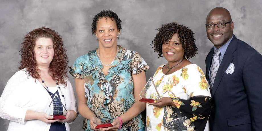 West Orange-Cove CCISD District Employees of the Year: Kathryn Knobloch, Phyllis Thibodeaux, and Ella Barlow pictured with superintendent Rickie Harris. Photo: WO-CCISD