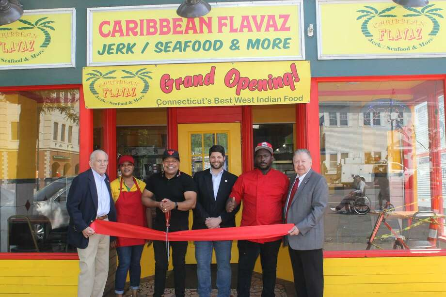 Caribbean Flavaz, a Jamaican restaurant at 560 Main St., Middletown, held a grand opening May 31. From left are Middlesex County Chamber of Commerce President Larry McHugh, cashier Andrea Lewis, owner Henry Aarons, Mayor Dan Drew, chef Owen Williams and immediate past chairman Jay Polke. Photo: Contributed Photo