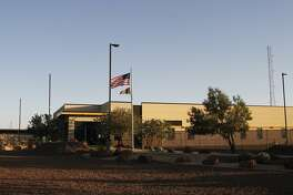 This June 20, 2019, frame from video shows the entrance of a Border Patrol station in Clint, Texas. A legal team, that interviewed about 60 children at the station near El Paso, says young migrants being held there are experiencing neglect and mistreatment at the hands of the U.S. government. (AP Photo/Cedar Attanasio)