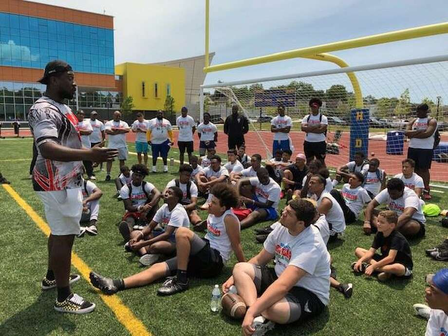 Day one of a two-day football camp at Harding High School on Bond Street in Bridgeport, Conn. Photo: Contributed Photo / Bridgeport Police Department