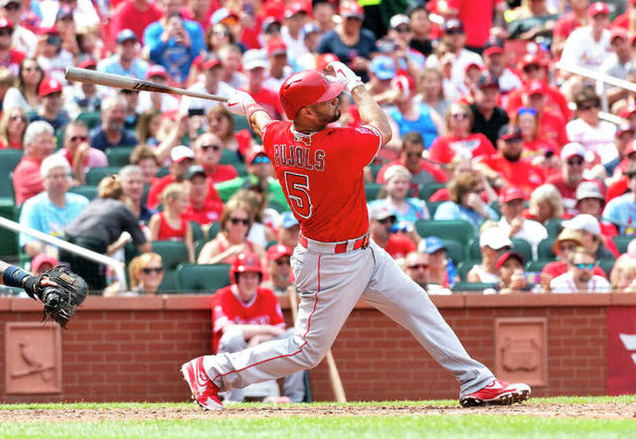 The Angels' Albert Pujols hits a home run in seventh inning of a Saturday's game against the Cardinals at Busch Stadium. Photo: AP Photo