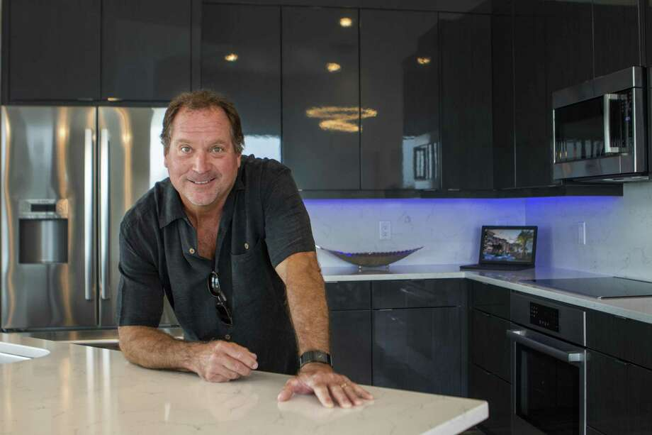 Owner and developer Jim Winkler poses inside the kitchen of a condominium Thursday at The Shoreline condominiums in Montgomery. Photo: Cody Bahn, Houston Chronicle / Staff Photographer / © 2019 Houston Chronicle
