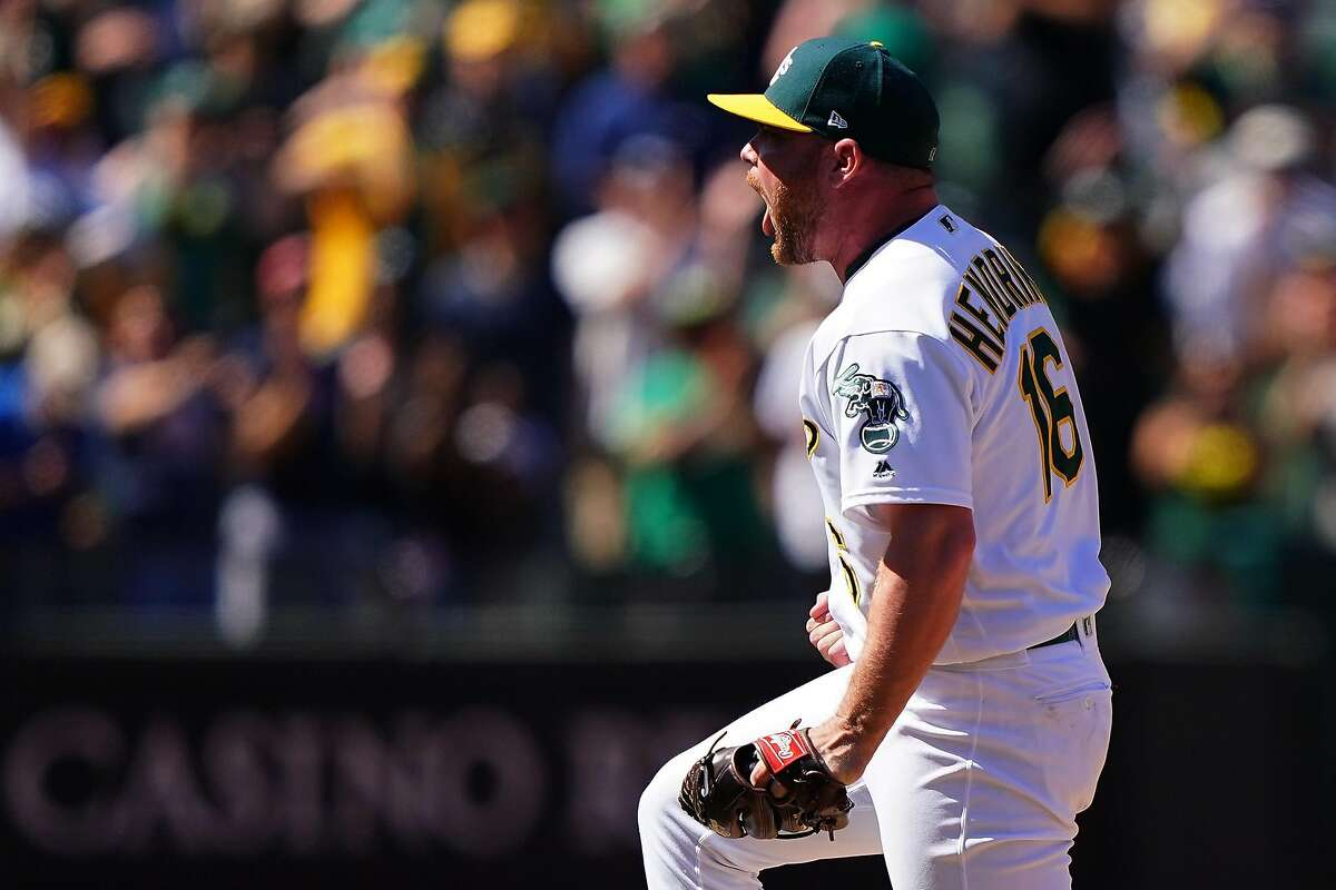 OAKLAND, CA - JUNE 22: Liam Hendriks #16 of the Oakland Athletics reacts to getting the save and beating the Tampa Bay Rays at Oakland-Alameda County Coliseum on June 22, 2019 in Oakland, California. (Photo by Daniel Shirey/Getty Images)