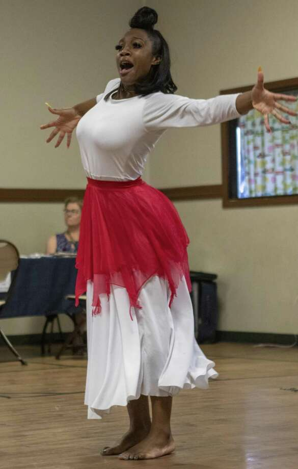 Dancer Denisha Felder performs a gospel dance Saturday during a Juneteenth celebration at the Oscar Johnson, Jr. Community Center. June 19 marked the 154th anniversary of the end of slavery for African Americans in Texas. Photo: Cody Bahn, Houston Chronicle / Staff Photographer / © 2019 Houston Chronicle