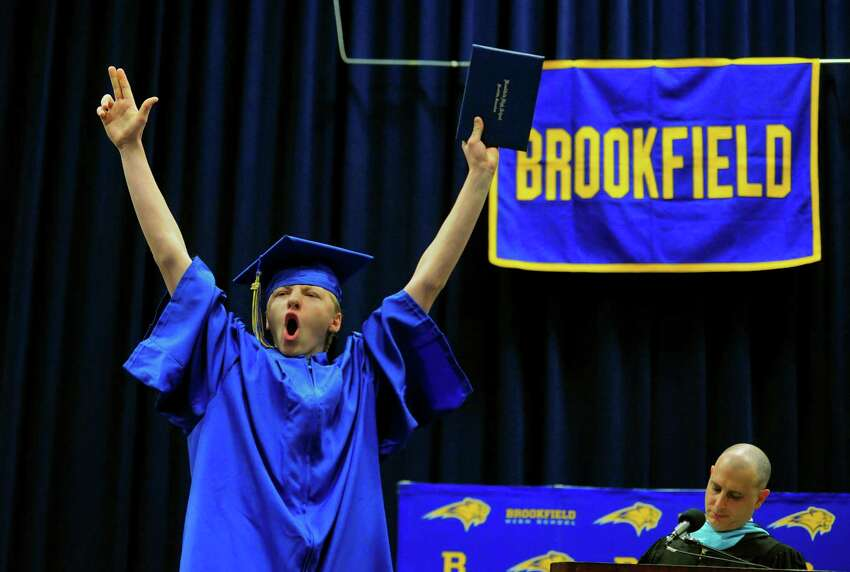 Graduate Tanner Carlson cheers after getting his diploma durnig Brookfield High School's 53rd Commencement Exercises at at the O'Neill Center at Western Connecticut State University in Danbury, Conn., on Saturday June 22, 2019.