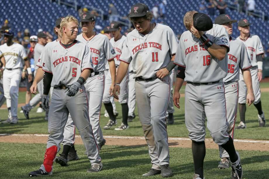 Texas Tech players walk off the field following their loss to Michigan in an NCAA College World Series baseball elimination game in Omaha, Neb., Friday, June 21, 2019. (AP Photo/Nati Harnik) Photo: Nati Harnik/Associated Press