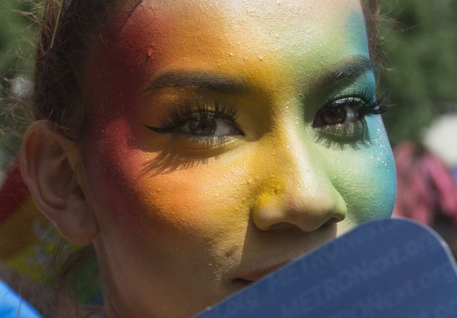A woman, who wishes not to use her name, has rainbow color on her face to gather at Houston City Hall to celebrate the Houston Pride Festival on Saturday, June 22, 2019, in Houston. Photo: Yi-Chin Lee, Staff / Staff Photographer / © 2019 Houston Chronicle