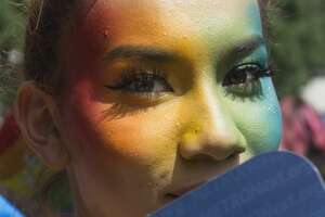 A woman, who wishes not to use her name, has rainbow color on her face to gather at Houston City Hall to celebrate the Houston Pride Festival on Saturday, June 22, 2019, in Houston.
