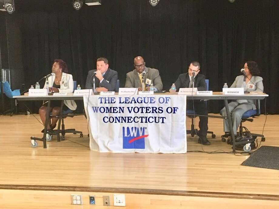 The five candidates for interim superintendent of schools in Bridgeport answer questions at a League of Women Voters forum at Claytor School on Saturday. Photo: Linda Conner Lambeck /
