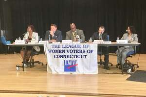 The five candidates for interim superintendent of schools in Bridgeport answer questions at a League of Women Voters forum at Claytor School on Saturday.