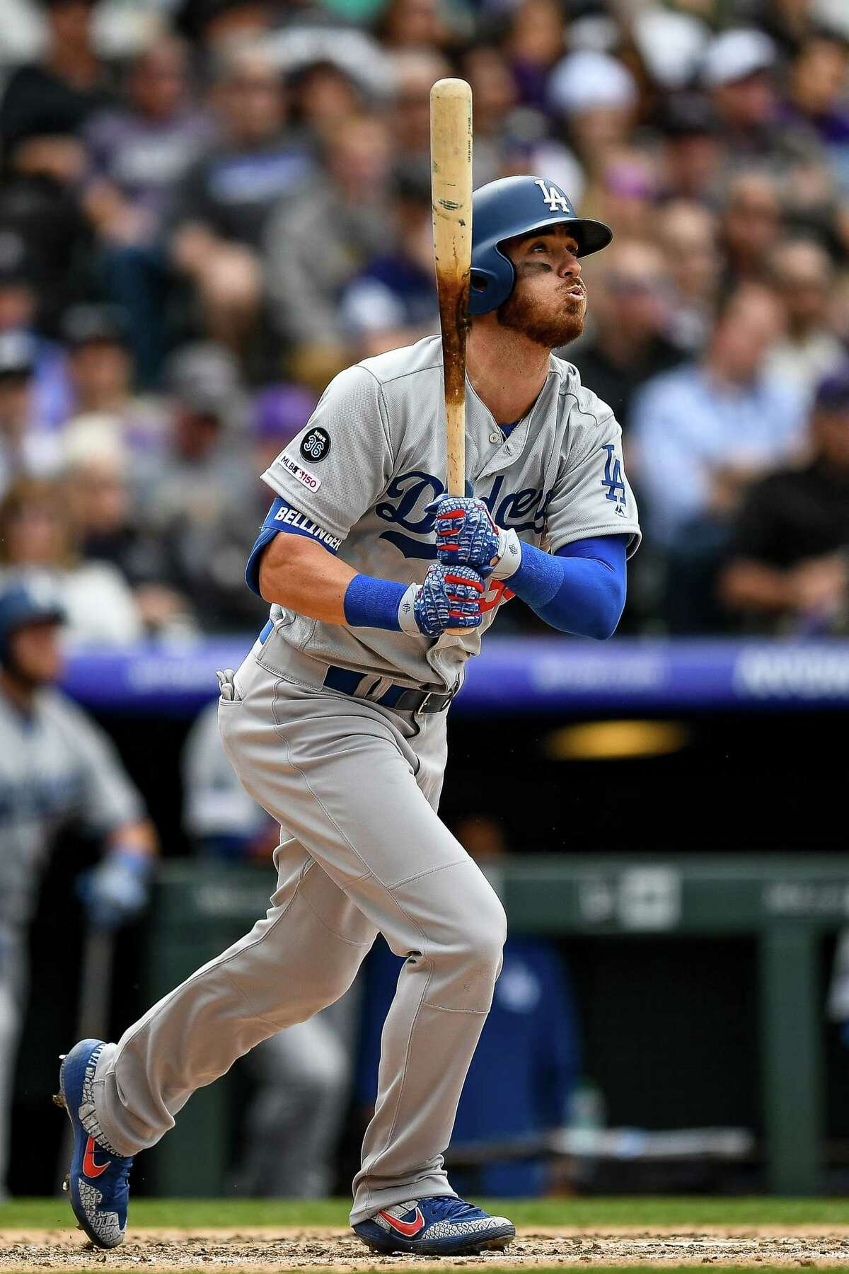 DENVER, CO - APRIL 5: Cody Bellinger #35 of the Los Angeles Dodgers watches the flight of a fifth inning three-run homer against the Colorado Rockies during the Colorado Rockies home opener at Coors Field on April 5, 2019 in Denver, Colorado. (Photo by Dustin Bradford/Getty Images)