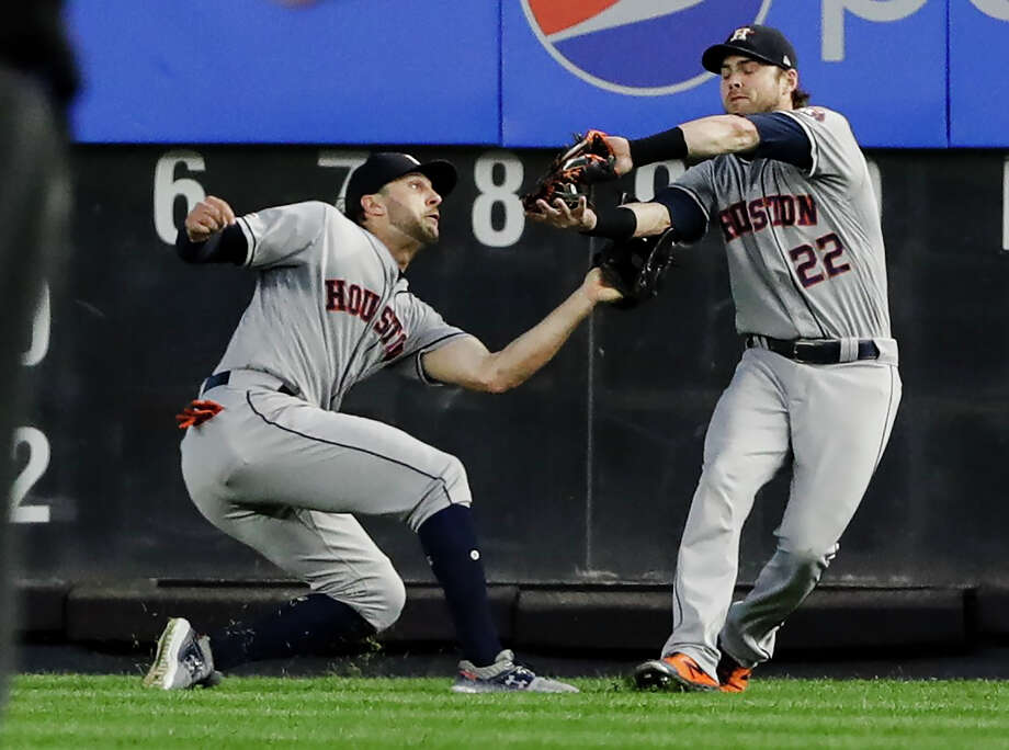 Houston Astros right fielder Josh Reddick (22) and center fielder Jake Marisnick collide as Reddick makes the catch for the out on New York Yankees' Austin Romine to end the fifth inning of a baseball game Saturday, June 22, 2019, in New York. (AP Photo/Frank Franklin II) Photo: Frank Franklin II/Associated Press / Copyright 2019 The Associated Press. All rights reserved.