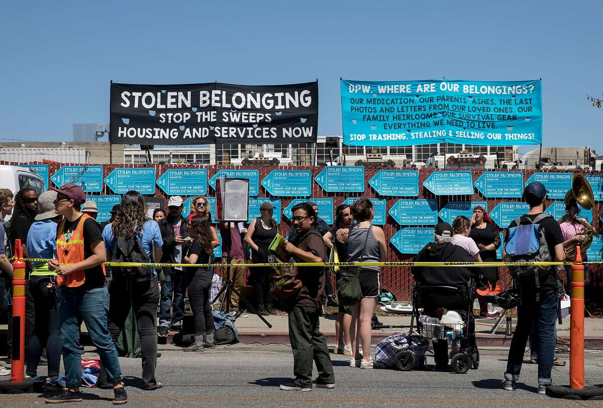 Dozens participate in a protest highlighting San Francisco Department of Public Works' controversial practice of street sweeping and property confiscation held outside of San Francisco Department of Public Works yard in San Francisco, Calif. Friday, June 21, 2019.