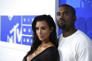 Kim Kardashian West, left, and Kanye West arrive at the 2016 MTV Video Music Awards in New York.