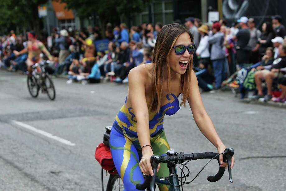 Cyclists participate in the naked bike ride during the 31st annual Fremont Solstice Parade, June 22, 2019. Photo: Genna Martin, SEATTLEPI / GENNA MARTIN