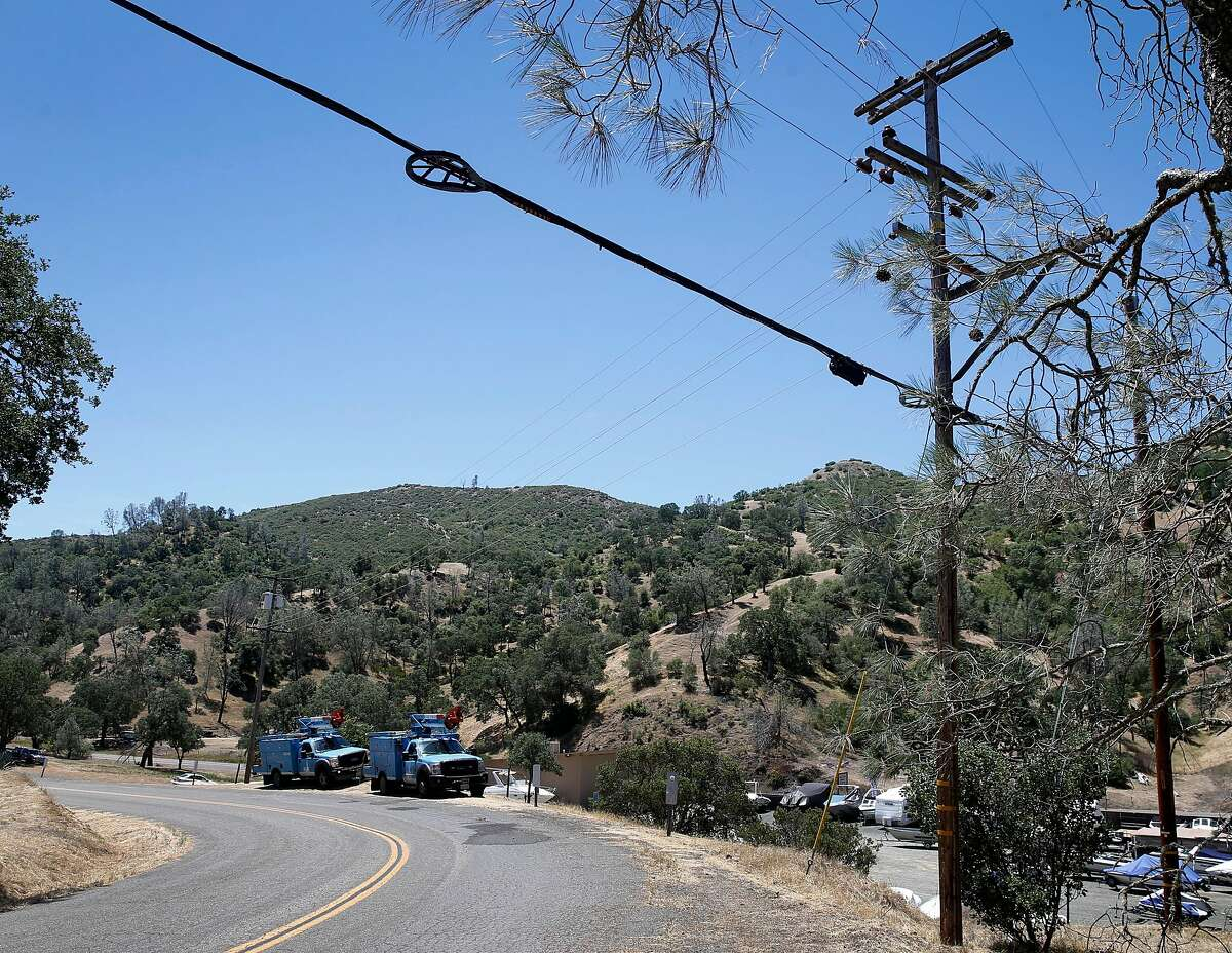 A PG&E crew is stationed on Spanish Flat Loop Road to observe overhead power lines and monitor wind conditions in Lake Berryessa, Calif. on Saturday, June 8, 2019. PG&E enabled its public power safety shutoff protocol resulting in outages for 1,600 customers in the area.